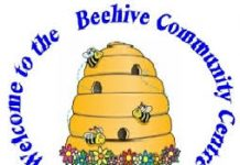 image of a cartoon beehive with flowers and bees