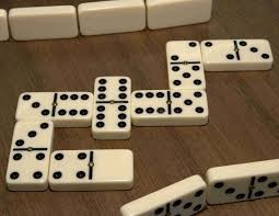white dominoes with black spots