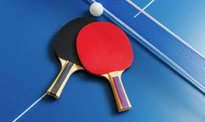image of table tennis bats and ping pong ball