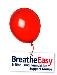 big red balloon holding up the Breathe Easy poster