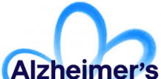 image of a blue open flower with the words Alzheimer's Society United Against Dementia