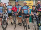 photo of a group posing for aphotot on their bicycles