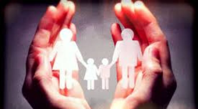 image of cupped hands and a paper cut out family holding hands