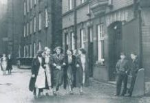 sepia photo of life in Wigan ilast century