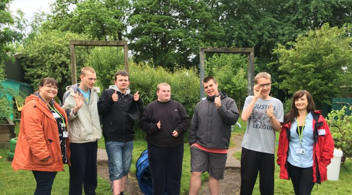 Young people from Landgate School in the garden with staff from Wigan Council Karen Campbell and Laura Reay (2) Photo