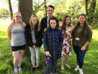 photo of some of the young people involved in the group and Wigan Council Community Deal Worker, Liz Prescott