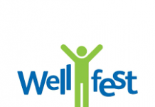 cartoon figure of a green man with his hands held high and the word Wellfest