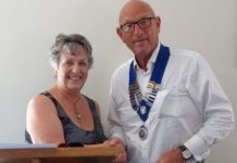 photo of Rotary club of Wigan President handing over to new President John
