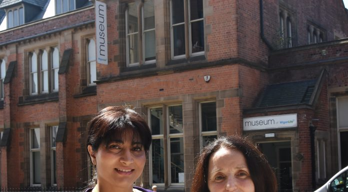photo of Cllr and JOan Livesey standing outside the Museum of Wigan Life