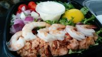 photo of a mail meal with prawns and salad
