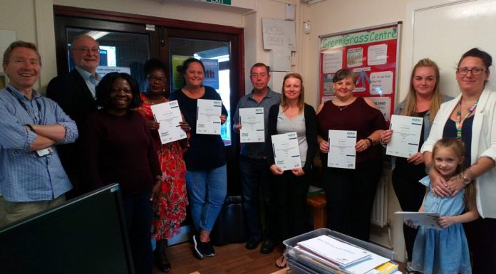 Deputy leader of Wigan Council Councillor Keith Cunliffe, second left, presents the Hag Fold alcohol health champions with their certificates