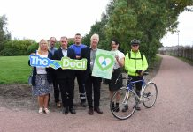 officials from Dowhigh and wigan Council with members of the public at Standish Line