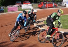 Astley & Tyldesley's Pawel Idziorek (right) on his way to a race win