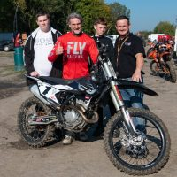 Carl Fogarty with founder of Bike Mech, Matt Winstanley and young people who attend the project
