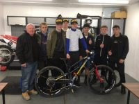 young people at the Bike Mech project with founder Ken Winstanley and Elliott Heap
