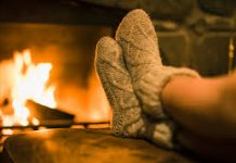 image of someone putting their feet up in front of a blazing fire
