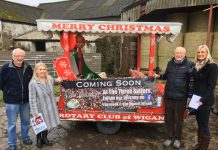 photo of Wigan Rotary Club with Santa Sleigh make a Donation to the Hamlet Cafe