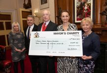Group holding cheque for Mayors Charity