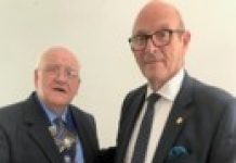 Left to right Rtn John Wright hands the chain of office to Rtn Mervyn Reeves.