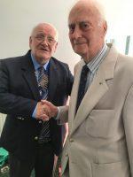 President Elect Mervyn Reeves awarding Honorary Membership to Rtn. John Coupe.