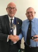 Rtn Stan Cooper Receiving his Paul Harris Sapphire Medal from Past President John Wright.