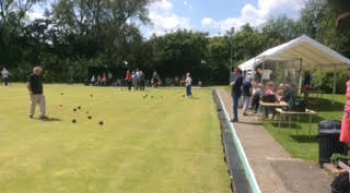 photo of people bowling at a community day