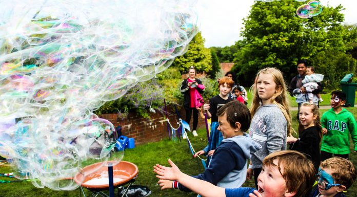 children playng with bubbles at Haigh Woodland Park