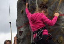 children tackling the rock climbing