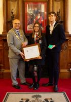 Rachel with the Mayor, Coun Steve Dawber, and his consort Oliver Waite in Wigan Town Hall.