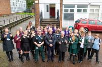 Some of the young people who took part in the event with staff from NW Ambulance Services, WWL NHS Foundation Trust and Greater Manchester Fire and Rescue Service.