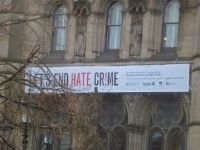 photo showing banner relating to lets end hate crime manchester