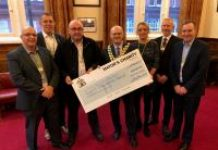 The Mayor of Wigan Council receiving the £8,000 cheque on behalf of the chosen charity