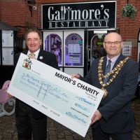 Mayor of Wigan Borough receives the cheque which will support his chosen charities