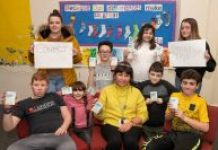 Young people from the Million Voices group with Wigan Council staff member Deb Hall and their Wordinary