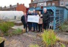 Ince ward councillors hand over the cheque to Wigan Borough Armed Forces HQ CIC