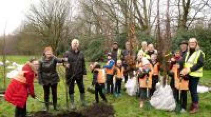 Coun Janice Sharratt, Coun David Molyneux, Wigan Council officers and pupils from Ince Primary School