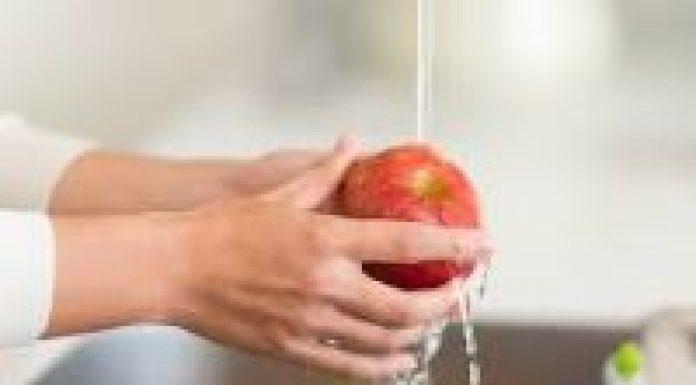 photo of someone washing an apple