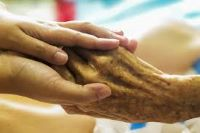younger hands holding older hands