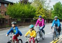 family cycling on a road