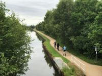 three cyclists on canal path