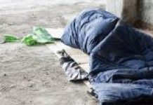 image of a homeless person asleep