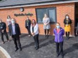 colleagues stood outside of Hyndelle lodge