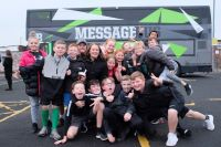 photo of children in front of the message bus