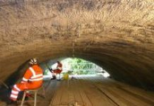 men waterproofing in tunnel