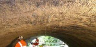 men waterproofing in tunnel